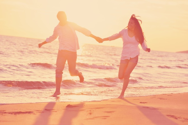 young couple on beach have