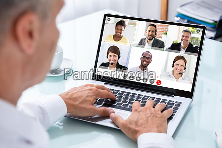 businessman videoconferencing with doctor on laptop